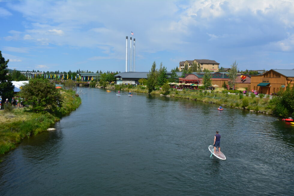 Bend, OR -- Paddleboarding down the Deschutes River